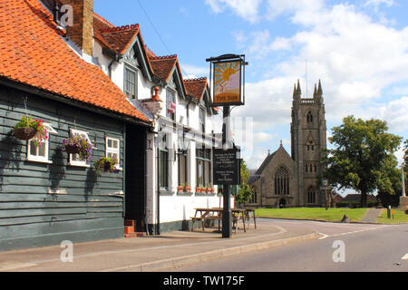The Sun Pub with St Thomas a Becket Church in background – Northaw Village, Hertfordshire during summer. - Stock Photo