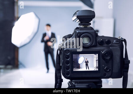Closeup view of professional camera in studio - Stock Photo