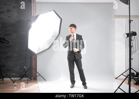 Professional model posing in studio - Stock Photo