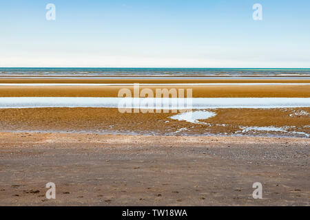 Oostduinkerke, Belgium - June 19, 2019: Layered minimalistic seascape with blue, green and orange tints - Stock Photo