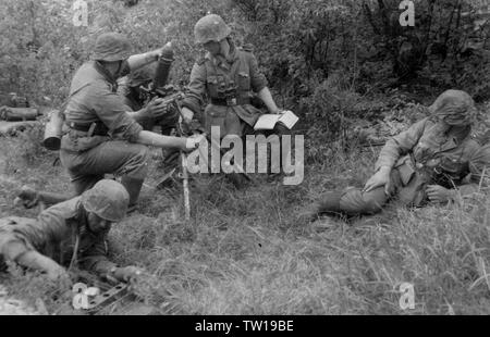 German Soldiers load a Mortar in France 1940 - Stock Photo