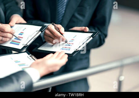 close up.business team analyzes the financial profit of the company. - Stock Photo