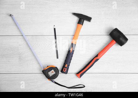Carpenter tools on laminated flooring - Stock Photo