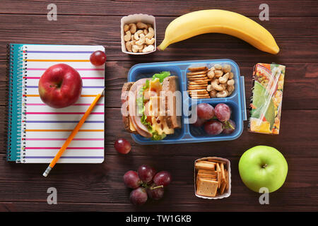 School lunch and stationery on table - Stock Photo