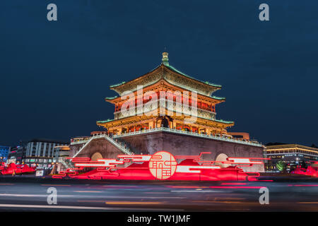 Beautiful and romantic night view of the Gulou of Xi'an Clock Tower with brilliant lights - Stock Photo