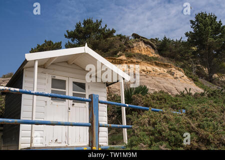 New blue and white Beach hut on Bournemouth beach between Alum Chine and Branksome Chine - Stock Photo
