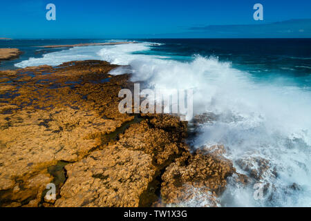 Indian Ocean breaking onto a reef, Northwest Australia. - Stock Photo