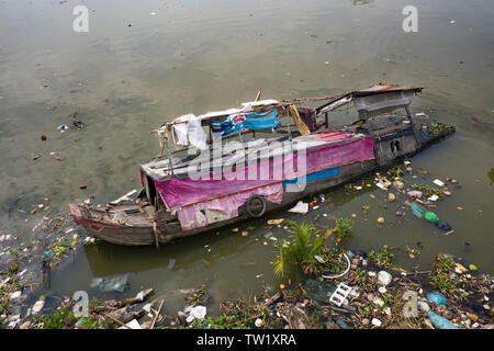 A sunken traditional Vietnamese River Boat (House Boat) in a canal running into the Saigon River in Ho Chi Minh City, Vietnam. Loss and tragedy - Stock Photo