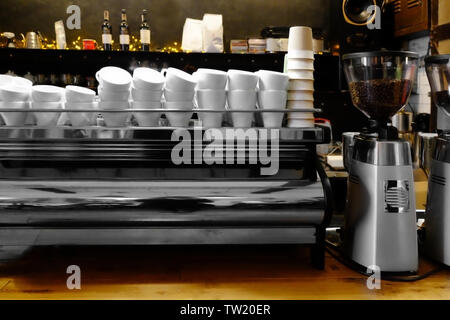 Clean cups on table at cafe - Stock Photo