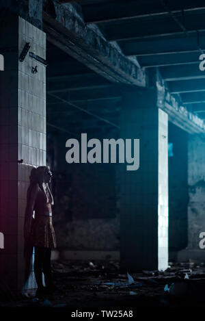 Young woman in dark horror room - Stock Photo