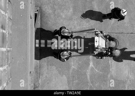fire fighters with 13.5m ladder, working at hight - Stock Photo