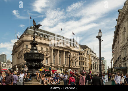 London - July 6th 2014: Piccadilly Circus crowded with tourists in summer - Stock Photo