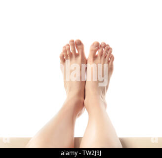 Legs of young woman taking rest, on white background - Stock Photo