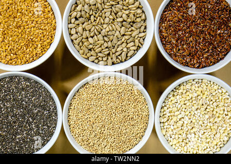 Bowl of Mixed Healthy Dry Seeds and Grains Including Linseed Sunflower Chia Pearl Barley and Quinoa - Stock Photo