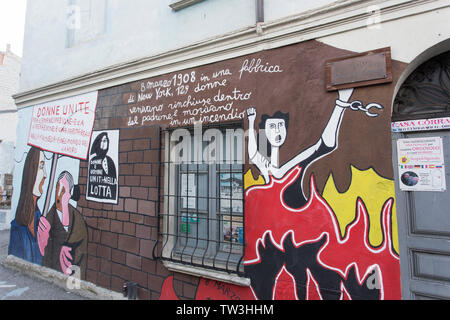 Orgosolo, Italy - December 29, 2018: Murals wall paintings about political and historical facts in Orgosolo, Sardinia, Italy - Stock Photo