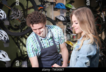 Young couple in bicycle shop - Stock Photo