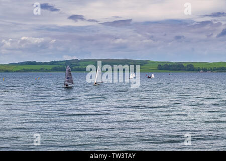 Largs, Scotland, UK - June 01, 2019: Some small sailing craft  off of Largs Yacht Haven out on the firth of Clyde at largs in Scotland's west coast. - Stock Photo