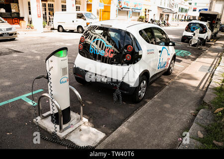 Blue SG electric car sharing scheme in Singapore with charging stations offering a clean pollution free  point to point transport network. - Stock Photo