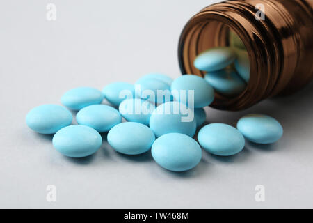 Glass bottle and pills on light background - Stock Photo