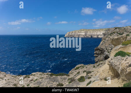 a coast with rough seas the Blue Hole in San Lawrenz on Gozo , azure window - Stock Photo