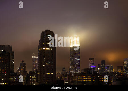 New York, USA. May 5th, 2019. City skyline at night. Aerial view of Manhattan skyscrapers and Empire state building, illuminated