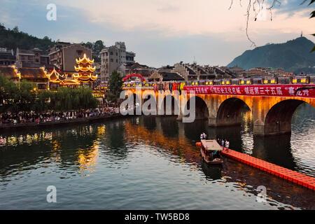 Night view of bridge and pavilion on Wuyang River, Zhenyuan, Guizhou Province, China - Stock Photo
