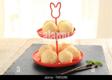 Dessert stand with delicious vanilla ice-cream balls on slate plate - Stock Photo