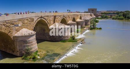 Panorama of the roman bridge and city gate in Cordoba, Spain - Stock Photo