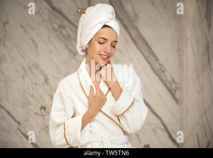 Beautiful young woman after shower in bathroom - Stock Photo