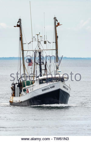 New Bedford, Massachusetts, USA - June 17, 2019: Commercial fishing boat Rebecca Mary, hailing port South Kingstown, Rhode Island, heading into New Be - Stock Photo