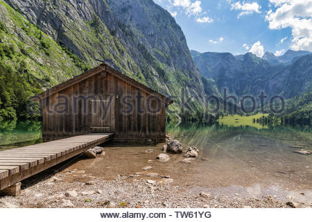 Beautiful view of traditional wooden boat house at the shores of famous Lake Obersee in scenic Nationalpark Berchtesgadener Land. - Stock Photo