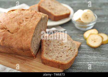 Sliced banana bread on wooden board - Stock Photo