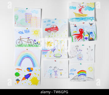 Colorful children's drawings on white background - Stock Photo