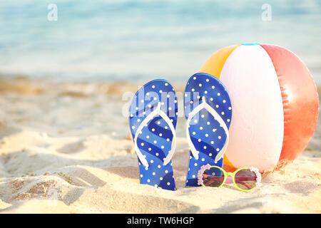 Beach accessories on sand at sea resort - Stock Photo