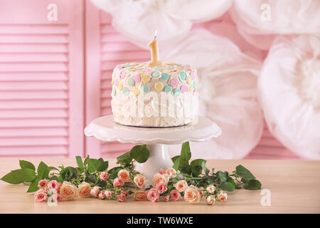 Cake with candle for first birthday on table - Stock Photo