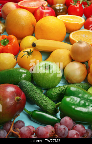 Creative composition made of fruits and vegetables in rainbow colors on table - Stock Photo