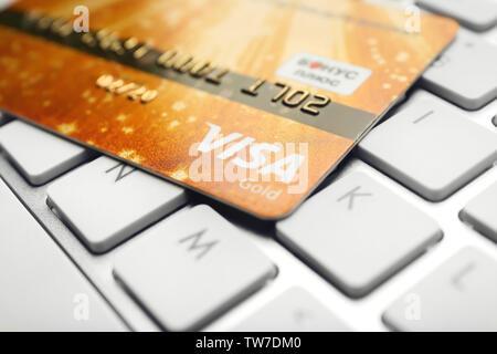 KIEV, UKRAINE - OCTOBER 2, 2017: Golden Visa credit card on keyboard - Stock Photo
