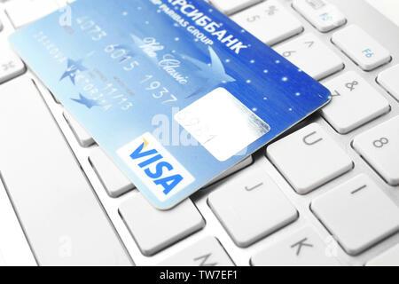 KIEV, UKRAINE - SEPTEMBER 26, 2017: Visa credit card on keyboard, closeup - Stock Photo