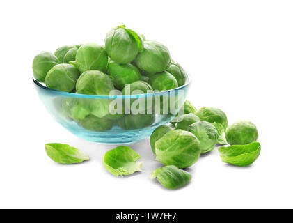 Fresh Brussels sprouts in glass bowl on white background - Stock Photo