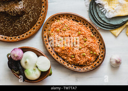 mexican rice and mole poblano, traditional food in Mexico - Stock Photo
