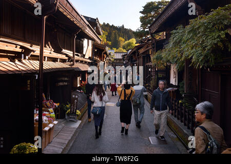 Busy with tourists Kami-Sannomachi, old town market street of Takayama. Merchant town street lined with shops and restaurants. Japan - Stock Photo
