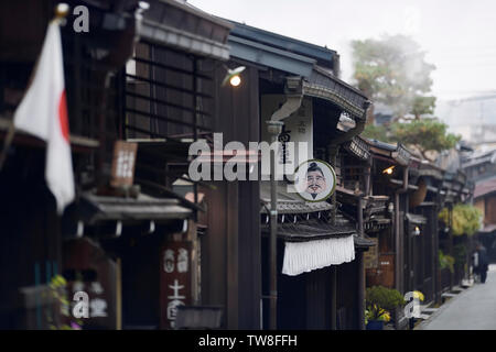 Kamisannomachi, old town merchant street with signs of shops and restaurants in Takayama city. Odoriya Kimono store sign. Japan - Stock Photo