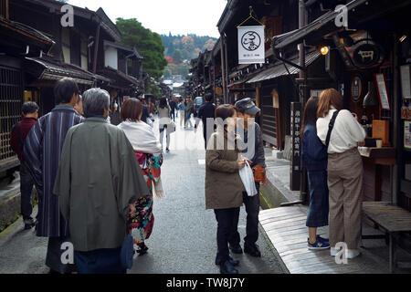Busy with tourists old town market street of Takayama city. Kamisannomachi merchant town lined with shops and restaurants. Hida-Takayama, Gifu prefect - Stock Photo