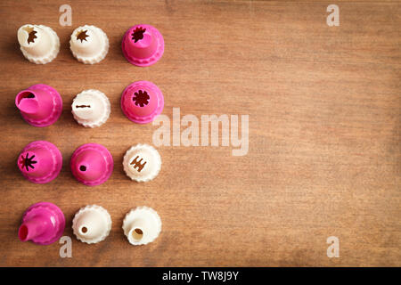 Kitchen utensils for pastries on wooden background - Stock Photo