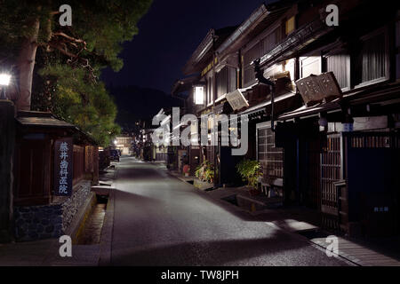 Kamisannomachi, old town in Takayama city at night with lit up street lights and shop signs. Hida-Takayama, Gifu prefecture, Japan travel photography - Stock Photo