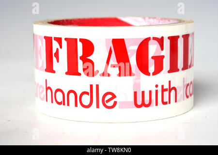 Roll of fragile tape on the White Blackground - Stock Photo