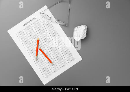 Broken pencil, glasses and test sheet on table, top view. Preparation for exam - Stock Photo
