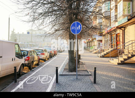 Bicycle road with special marking on city street - Stock Photo