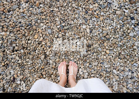 Selfie Young Woman of Feet in Fashion Shoes on Stones Floor. Beautiful Girl Standing is Foot & Slim Legs Seen from Above on Road Street. Flat Shoe - Stock Photo