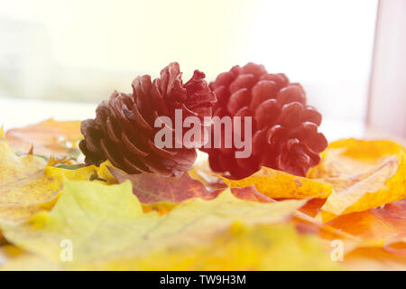 two bumps on autumn leaves, space for text - Stock Photo